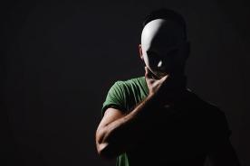 man-wearing-mask-in-dark