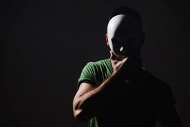 man-wearing-mask-in-dark